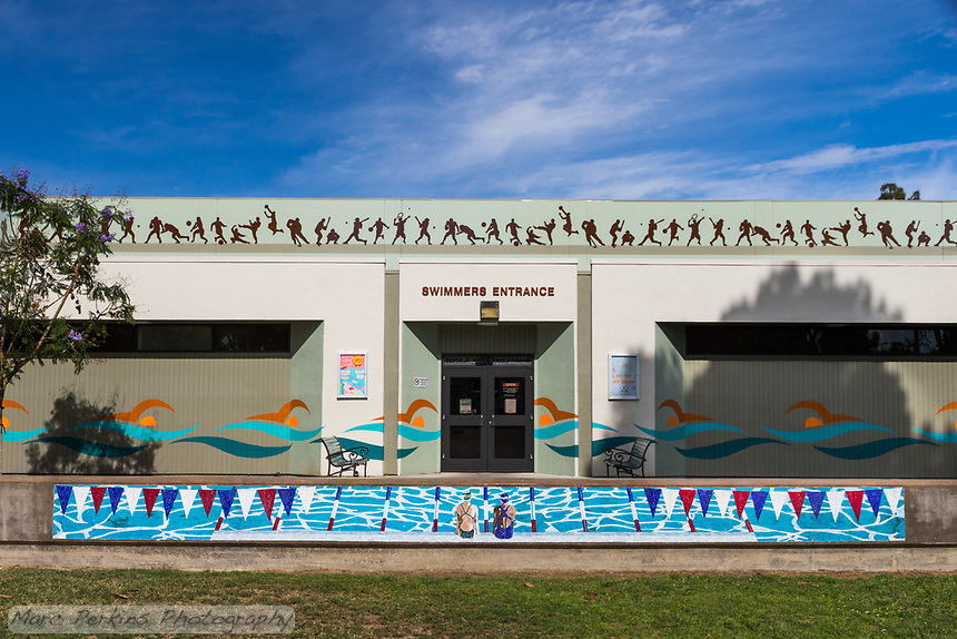 The beautiful swimmers mural in front of the swimmers entrance to the South Gate Sports Center at South Gate Park.