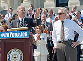 """United States Vice President Joe Biden, left, makes remarks as he joins Democratic members of the US House of Representatives and US Senate assembling on the East Steps of the US Capitol to call on Republican leadership in both legislative bodies to schedule votes on funding to combat the Zika Virus, to prohibit people on the federal """"no fly"""" list from purchasing guns, and to conduct confirmation hearings and schedule a vote on the confirmation of Judge Merrick Garland as Associate Justice of the US Supreme Court in Washington, DC on Thursday, September 8, 2016.  US House Minority Leader Nancy Pelosi (Democrat of California), center, and United States Senate Minority Leader Harry Reid (Democrat of Nevada), right, listen.<br /> Credit: Ron Sachs / CNP"""