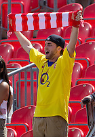 20 July 2013: A fan tries to get the attention of New York Red Bulls forward Thierry Henry #14 while on the pitch for warm-ups during an MLS regular season game between the New York Red Bulls and Toronto FC at BMO Field in Toronto, Ontario Canada.<br /> The game ended in a 0-0 draw.