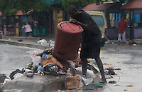 A resident throws garbage on the street while Tropical Storm Emily moves through Dominican Republic and Haiti;  the Tropical Storm Emily dissipated Thursday afternoon , but could regenerate in the next few days, according to the National Hurricane Center.  August 4, 2011 VIEWpress/  Kena Betancur