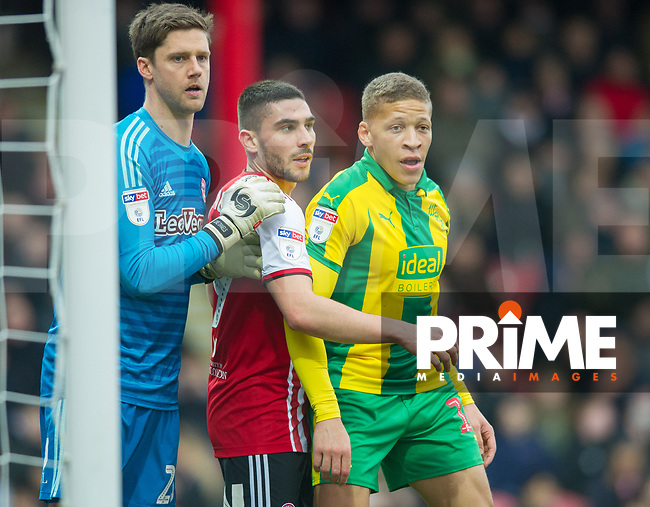 Brentford Luke Daniels and Brentford Neal Maupay and WBA's Dwight Gayle during the Sky Bet Championship match between Brentford and West Bromwich Albion at Griffin Park, London, England on 16 March 2019. Photo by Andrew Aleksiejczuk / PRiME Media Images.
