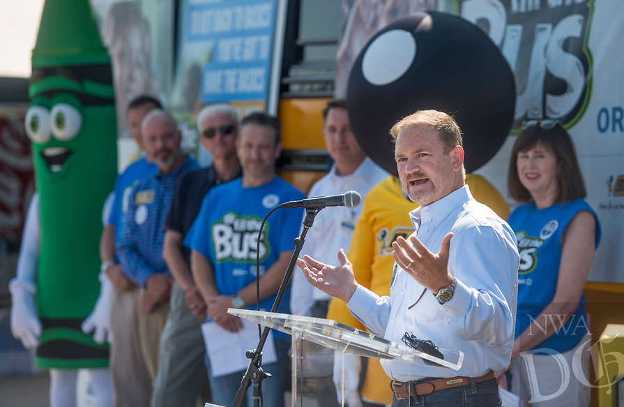 NWA Democrat-Gazette/BEN GOFF @NWABENGOFF<br /> Joe Lloyd, United Way of Northwest Arkansas board chairman, speaks Friday, Aug. 3, 2018, during a press event at the United Way of Northwest Arkansas Fill the Bus drop-off location at the Walmart Supercenter on Pleasant Crossing Boulevard in Rogers. Volunteers are manning busses at ten Walmart Supercenter locations in Northwest Arkansas and Pineville, Mo. from 9:00 a.m. to 3:30 p.m. Friday and Saturday to sort donated school supplies. The donations will go directly to the district the Walmart location is in. Over the past ten years, the annual drive has helped more than 35,000 students in 12 school districts get the supplies they need to start the school year.