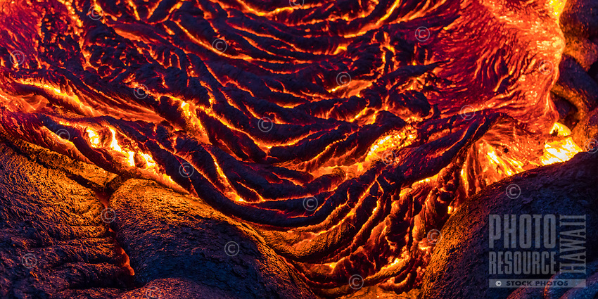 A close-up of cooling pahoehoe (smooth, unbroken lava), Hawai'i Volcanoes National Park, Puna district, Hawai'i Island, December 2017.