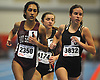 Roshni Singh of Bay Shore, left, competes in the 3,000 meter run during the Suffolk County girls winter track and field state qualifiers at Suffolk Community College Grant Campus in Brentwood on Monday, Feb. 12, 2018. She won the event with a time of 10:21.81.