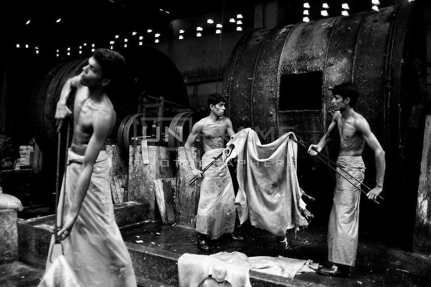 Bangladeshi workers process leather inside a factory at the highly polluted Hazaribagh tannery area on the banks of the River Buriganga in Dhaka, Bangladesh
