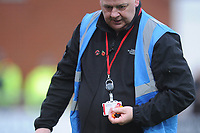 A steward removes lighters that were thrown onto the pitch by Blackpool fans<br /> <br /> Photographer Kevin Barnes/CameraSport<br /> <br /> The EFL Sky Bet League One - Fleetwood Town v Blackpool - Saturday 7th March 2020 - Highbury Stadium - Fleetwood<br /> <br /> World Copyright © 2020 CameraSport. All rights reserved. 43 Linden Ave. Countesthorpe. Leicester. England. LE8 5PG - Tel: +44 (0) 116 277 4147 - admin@camerasport.com - www.camerasport.com