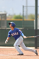 Isiah Kiner-Falefa #75 of the Texas Rangers bats during a Minor League Spring Training Game against the Kansas City Royals at the Kansas City Royals Spring Training Complex on March 20, 2014 in Surprise, Arizona. (Larry Goren/Four Seam Images)
