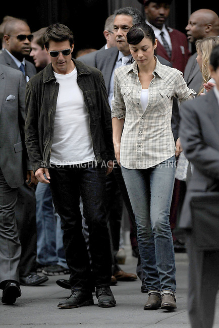 WWW.ACEPIXS.COM . . . . . .June 12, 2012...New York City.... Tom Cruise and Olga Kurylenko on the Oblivion film set at the Empire State Building on June 12, 2012 in New York City ....Please byline: KRISTIN CALLAHAN - ACEPIXS.COM.. . . . . . ..Ace Pictures, Inc: ..tel: (212) 243 8787 or (646) 769 0430..e-mail: info@acepixs.com..web: http://www.acepixs.com .