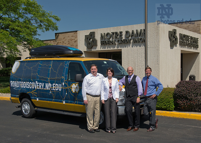 May 17, 2012; College of Science Dean Greg Crawford poses with management from Notre Dame Federal Credit Union in front of the support van for Crawford's bike ride across the United States to raise awareness and funds for the Ara Parseghian Medical Research Foundation...Photo by Matt Cashore/University of Notre Dame