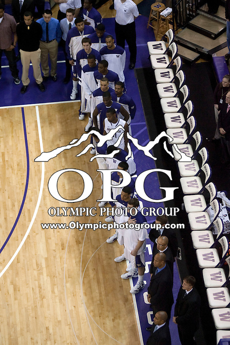 Jan 21, 2012:  Washington players line the bench for the playing of the national anthem against Stanford.  Washington defeated Stanford 76-63 at Alaska Airlines Arena Seattle, Washington...