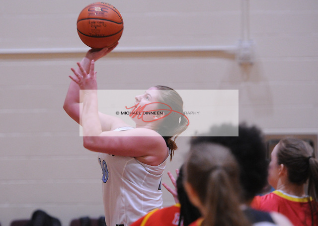 Chugiak's Layla Beam goes airborne to make a layup duiring the Mustangs' 76-28 win over West Valley. Photo by Michael Dinneen for the StarPhoto by Michael Dinneen for the Star