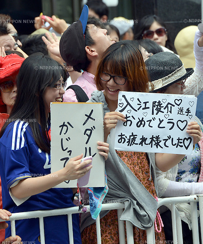 August 20, 2012, Tokyo, Japan - An estimated 500,000 people lined on both sides of the main street of Tokyo's Ginza shopping district welcome Japanese Olympians as they have the first ever homecoming parade on Monday, August 20, 2012, to honor their achievements at the 2012 summer Olympics in London. Seventy-six medal-winning athletes waved from atop road open-top double decker bus parading down the boulevard. (Photo by Natsuki Sakai/AFLO)