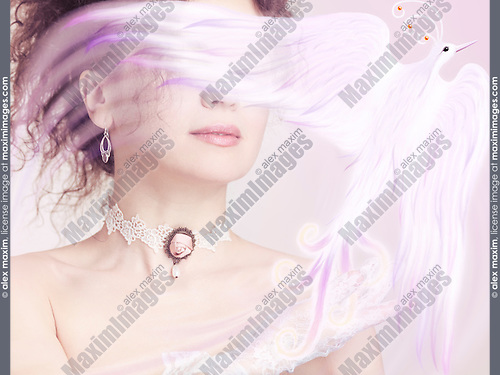 Woman holding a beautiful glowing magical bird in her hand, artistic photo illustration design