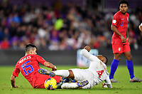 ORLANDO, FL - NOVEMBER 15: Alfredo Morales #15 of the United States and Derek Cornelius of Canada battle for a ball as Weston McKennie #8 of USA looks on during a game between Canada and USMNT at Exploria Stadium on November 15, 2019 in Orlando, Florida.