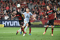 1st January 2020; Bankwest Stadium, Parramatta, New South Wales, Australia; Australian A League football, Western Sydney Wanderers versus Brisbane Roar; Dylan McGowan of Western Sydney Wanderers heads a cross towards goal - Editorial Use