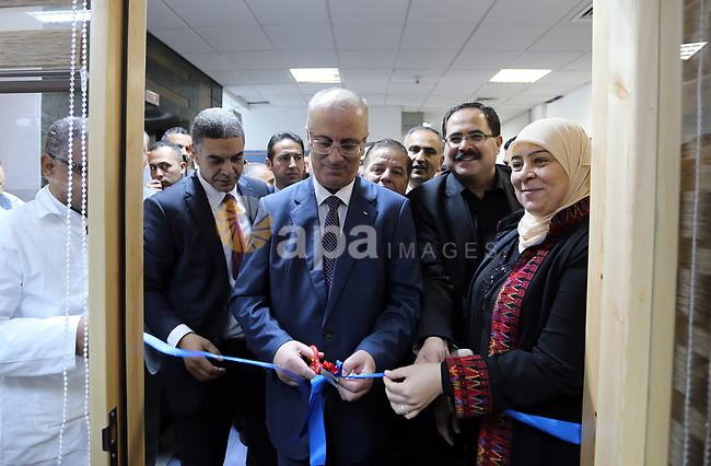 Palestinian Prime Minister, Rami Hamdallah, opens the new branch of Khadouri University, in the West Bank city of Ramallah, on August 23, 2017. Photo by Prime Minister Office