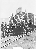Six men posed on front of engine #203 which is decorated with a star on the smokebox.<br /> D&amp;RG  Durango, CO  ca 1911