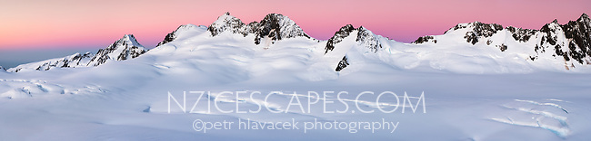 Twilight over mountain ranges of Southern Alps with Explorer Glacier crevasses in upper parts of Fox Glacier NEVE, Westland Tai Poutini National Park, West Coast, UNESCO World Heritage Area, New Zealand, NZ