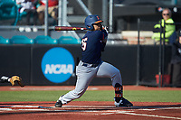 Taylor Jackson (15) of the Illinois Fighting Illini follows through on his swing against the Coastal Carolina Chanticleers at Springs Brooks Stadium on February 22, 2020 in Conway, South Carolina. The Fighting Illini defeated the Chanticleers 5-2. (Brian Westerholt/Four Seam Images)