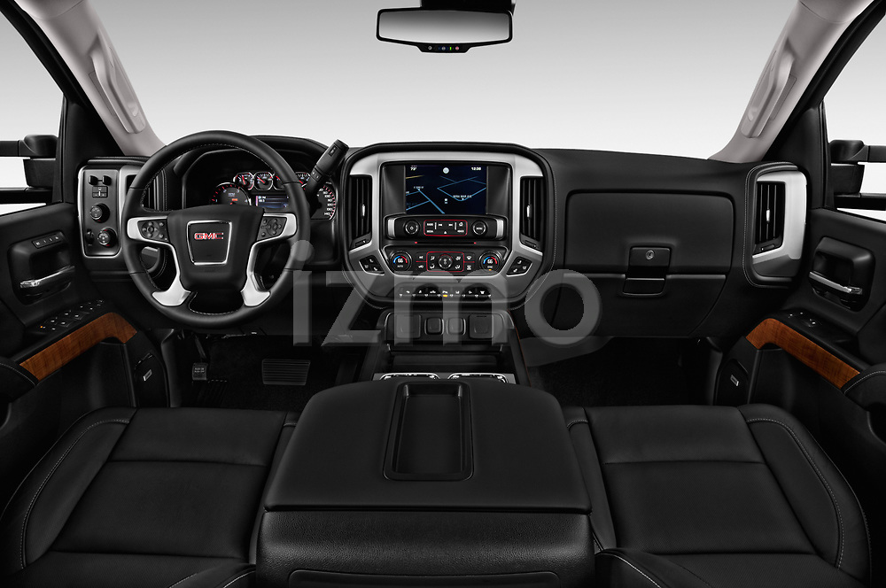 Stock photo of straight dashboard view of a 2018 GMC Sierra 3500HD 2WD Crew Cab Standard Box SLT 4 Door Pick Up