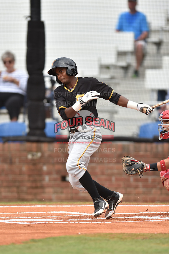 Bristol Pirates shortstop Pablo Reyes #15 swings at a pitch during a game against the Johnson City Cardinals at Howard Johnson Field July 20, 2014 in Johnson City, Tennessee. The Pirates defeated the Cardinals 4-3. (Tony Farlow/Four Seam Images)