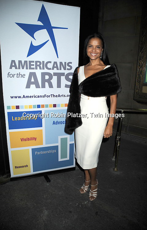 Victoria Rowell in white Sophie Sitbon dress