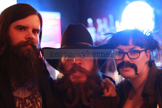 Beard enthusiast Thomas Smith from Dayton Ohio poses with friends at Cosmic Charlie's nightclub in Lexington, Ky. Jan. 31, 2012. Photo by Brandon Goodwin | Staff
