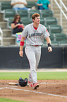 Zach Green (12) of the Lakewood BlueClaws walks away after striking out to end an inning in the game against the Kannapolis Intimidators at CMC-NorthEast Stadium on July 20, 2014 in Kannapolis, North Carolina.  The Intimidators defeated the BlueClaws 7-6. (Brian Westerholt/Four Seam Images)