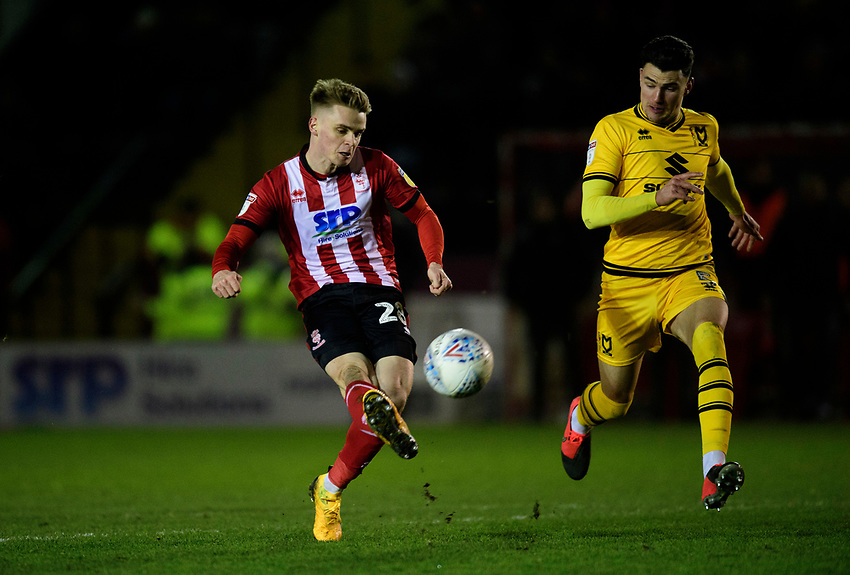 Lincoln City's Jake Hesketh puts an effort over the crossbar<br /> <br /> Photographer Chris Vaughan/CameraSport<br /> <br /> The EFL Sky Bet League One - Lincoln City v Milton Keynes Dons - Tuesday 11th February 2020 - LNER Stadium - Lincoln<br /> <br /> World Copyright © 2020 CameraSport. All rights reserved. 43 Linden Ave. Countesthorpe. Leicester. England. LE8 5PG - Tel: +44 (0) 116 277 4147 - admin@camerasport.com - www.camerasport.com