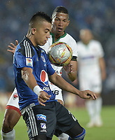 BOGOTA - COLOMBIA -07 -02-2015: Fernando Uribe (Izq.) jugador de Millonarios salta por el balón con Carlos Henao (Der.) jugador de Patriotas FC, durante partido entre Millonarios y Patriotas FC por la fecha 2 de la Liga Aguila I-2015, jugado en el estadio Nemesio Camacho El Campin de la ciudad de Bogota. / Fernando Uribe (L) player of Millonarios jumps for the ball with Carlos Henao (R) player of Patriotas FC, during a match between Millonarios and Patriotas FC for the  date 1 of the Liga Aguila I-2015 at the Nemesio Camacho El Campin Stadium in Bogota city, Photo: VizzorImage / Gabriel Aponte / Staff.