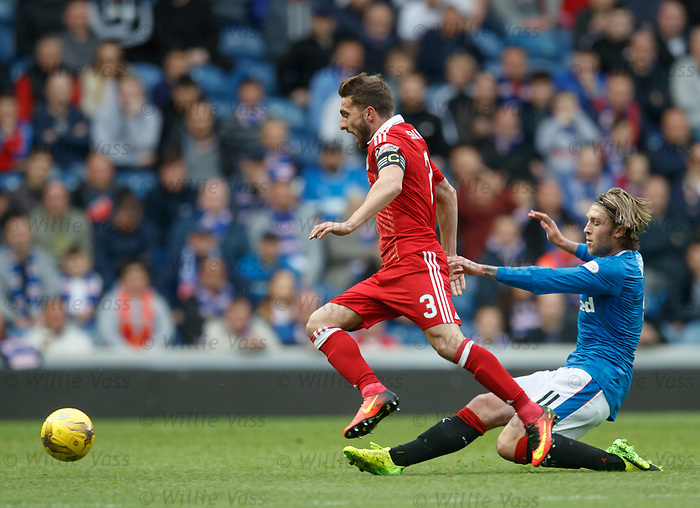 Josh Windass tries to tackle Graeme Shinnie