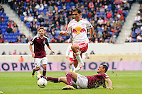 Rafa Marquez (4) of the New York Red Bulls jumps over a tackle by Tyrone Marshall (34) of the Colorado Rapids. The New York Red Bulls defeated the Colorado Rapids 4-1 during a Major League Soccer (MLS) match at Red Bull Arena in Harrison, NJ, on March 25, 2012.