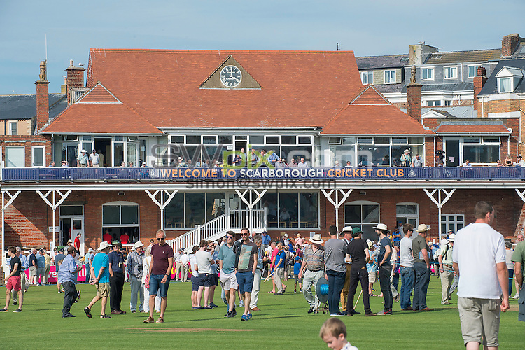 Picture by Allan McKenzie/SWpix.com - 23/08/2016 - Cricket - Specsavers County Championship - Yorkshire County Cricket Club v Nottinghamshire County Cricket Club - North Marine Road, Scarborough, England - The Scarborough Cricket CLub pavillion with fans and supporters on the outfield during the interval.
