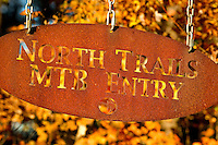 A metal sign marks the entrance to the North Trails MTB Entry at the US National Whitewater Center in Charlotte, NC. The USNWC, an ultimate adventure playground for outdoor enthusiasts, offers both water and land sports.