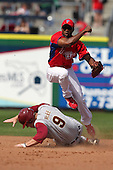 Philadelphia Phillies Josh Barfield #61 attempts to turn a double play as Mike McGee #9 slides in during a scrimmage vs the Florida State Seminoles  at Bright House Field in Clearwater, Florida;  February 24, 2011.  Philadelphia defeated Florida State 8-0.  Photo By Mike Janes/Four Seam Images