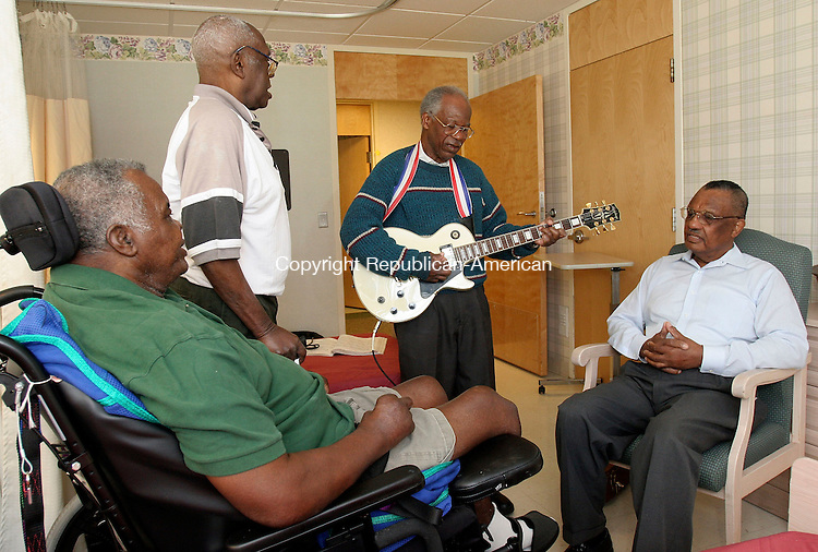 BLOOMFIELD, CT-09October 2006-100906TK02- (left to right) Residents of the Bloomfield Convalescent Home, Joseph Black and Charlie Palmer are visited and entertained by Joseph Forbes and Ken Paddyfote. Paddyfote was the former school superintendent of Region 15 and is currently on the Region 15 school board.  Tom Kabelka Republican-American (Bloomfield Convalescent Home, Joseph Black, Charlie Palmer, Joseph Forbes, Ken Paddyfote)