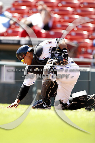 May 21, 2009:  Catcher Robinson Cancel of the Buffalo Bisons, International League Triple-A affiliate of the New York Mets, does some groundskeeping during a game at Coca-Cola Field in Buffalo, NY.  Photo by:  Mike Janes/Four Seam Images