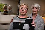 © Joel Goodman - 07973 332324 . 13 November 2013 . Blackley , UK . L-R Phyllis Robinson (73) and Lynn Richardson (46) (both correct) in Phyllis' home . Phyllis Robinson was robbed of her handbag containing £20,000 - her life savings - in cash after she withdrew the money from her bank to help her daughter , Lynn Richardson , launch her business . Photo credit : Joel Goodman