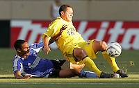 6 August 2005: Ricardo Clark of the Earthquakes tackles the ball against Eric Vasquez of the Crew during the first half of the game at Spartan Stadium in San Jose, California.  Earthquakes defeated Crew, 2-1.   Credit: Michael Pimentel / ISI