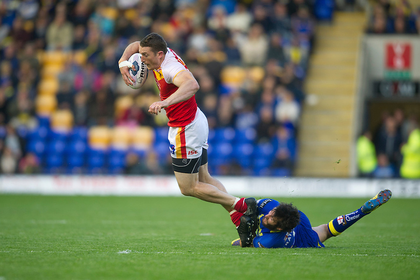 Catalan Dragons' Ben Pomeroy  is tackled by Warrington Wolves' Stefan Ratchford <br /> <br /> Photographer Stephen White/CameraSport<br /> <br /> Rugby League - First Utility Super League - Round 12 - Warrington Wolves v Catalan Dragons - Friday 9th May 2014 - The Halliwell Jones Stadium - Warrington<br /> <br /> &copy; CameraSport - 43 Linden Ave. Countesthorpe. Leicester. England. LE8 5PG - Tel: +44 (0) 116 277 4147 - admin@camerasport.com - www.camerasport.com