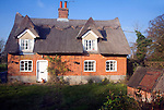 Thatched red brick country cottage, Sutton, Suffolk, England