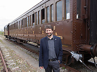 Il Ministro dei Beni Culturali e del Turismo Dario Franceschini posa davanti a un treno d'epoca degli anni Venti in occasione della presentazione degli itinerari storici proposti dal Ministero dei Beni Culturali e del Turismo e dalla Fondazione FS Italiane, sui binari della stazione di Torrenieri-Montalcino, lungo il tracciato dell'antica ferrovia della Val d'Orcia, 11 aprile 2015.<br /> Italian Culture and Tourism Minister Dario Franceschini portrayed in front of a vintage train of the twenties traveling on the occasion of the presentation of the historical tours proposed by the Italian Culture and Tourism Minister and Fondazione FS Italiane (Italian Railways Foundation), at Torrenieri-Montalcino's railway station, along the Val d'Orcia, Tuscany, 11 April 2015.<br /> UPDATE IMAGES PRESS/Riccardo De Luca
