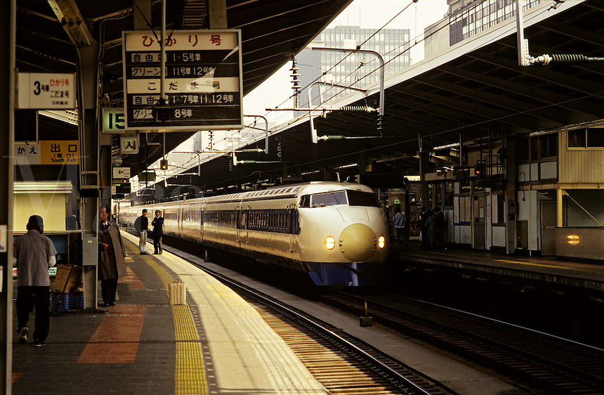 Japan. Tokyo. Shinkanzen/Shinkenzen bullet train at railway station. The Shinkanzen was the first operational high speed train in Japan and runs on a dedicated network of tracks throughout the country..