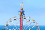 Fair goers enjoy the thrill of a fast moving ride.