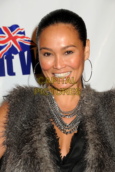 TIA CARRERE.2nd Annual Genlux Britweek Designer of the Year Fashion Awards held at Smashbox Studios Hollywood, West Hollywood, California, USA..May 8th, 2010.headshot portrait black chains hoop grey gray sleeveless fur gilet necklace smiling earrings.CAP/ADM/BP.©Byron Purvis/AdMedia/Capital Pictures.