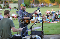 NWA Democrat-Gazette/MICHAEL WOODS • @NWAMICHAELW<br /> Bryan Hembree with Smokey & The Mirror plays the guitar during their show Tuesday September 29. 2015 at the Botanical Garden of the Ozarks in Fayetteville. It was the final free concert of the 2015 Summer Concert Series at the garden.  Smokey & The Mirror is a husband and wife duo Bryan and Bernice Hembree of Fayetteville. The Hembrees spent 7 years touring nationally as members of folk/bluegrass trio 3 Penny Acre.
