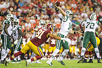 Landover, MD - August 16, 2018: New York Jets quarterback Sam Darnold (14) avoids the sack by Washington Redskins linebacker Ryan Kerrigan (91) during the preseason game between New York Jets and Washington Redskins at FedEx Field in Landover, MD.   (Photo by Elliott Brown/Media Images International)