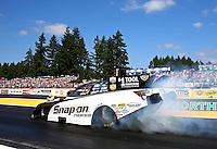 Aug. 4, 2013; Kent, WA, USA: NHRA funny car driver Cruz Pedregon during the Northwest Nationals at Pacific Raceways. Mandatory Credit: Mark J. Rebilas-USA TODAY Sports