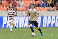 Houston, TX - Friday December 11, 2016: Ian Harkes (16) of the Wake Forest Demon Deacons brings the ball up the field against the Stanford Cardinal at the NCAA Men's Soccer Finals at BBVA Compass Stadium in Houston Texas.