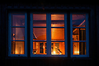 Looking in window of Singi hut at night, Kungsleden trail, Lappland, Sweden
